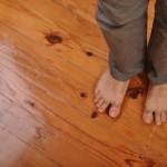 bare feet on wood floor