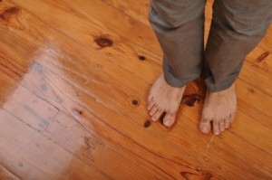 bare feet on wood floor
