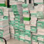 Dozens of shoe boxes piled up